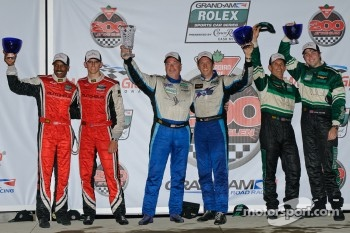 GT podium: class winners Steven Bertheau and Spencer Pumpelly, second place Bill Lester and Jordan Taylor, third place John Potter and Craig Stanton