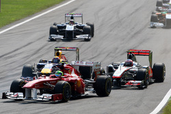Felipe Massa, Scuderia Ferrari leads Mark Webber, Red Bull Racing and Jenson Button, McLaren Mercedes