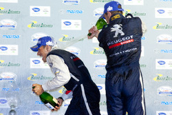 P1 podium: Stéphane Sarrazin and Alexander Wurz celebrate