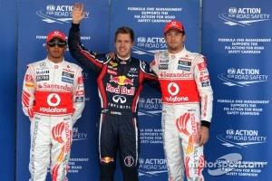 Third place Lewis Hamilton, McLaren Mercedes, pole winner Sebastian Vettel, Red Bull Racing and second place Jenson Button, McLaren Mercedes