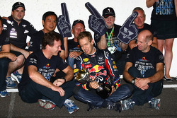 Sebastian Vettel, Red Bull Racing new world champion celebrates with the team, Christian Horner, Red Bull Racing, Sporting Director, Adrian Newey, Red Bull Racing, Technical Operations Director, Norbert Vettel