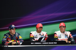 Post-qualifying interview: Sebastian Vettel, Red Bull Racing with Lewis Hamilton, McLaren Mercedes and Jenson Button, McLaren Mercedes