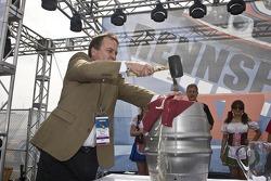 Monterey Mayor Chuck Della Sala taps the keg to open the Porsche Park and Biergarten