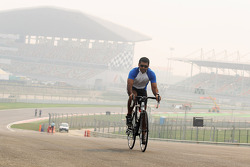 Karun Chandhok cycles the track as preparations continue