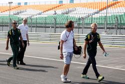 Heikki Kovalainen, Team Lotus walks the track