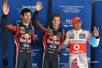 Mark Webber, Red Bull Racing with poleman Sebastian Vettel, Red Bull Racing and Lewis Hamilton, McLaren Mercedes