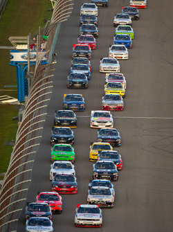 Elliott Sadler, Kevin Harvick Inc. Chevrolet and Brad Keselowski, Penske Racing Dodge lead the field on a restart