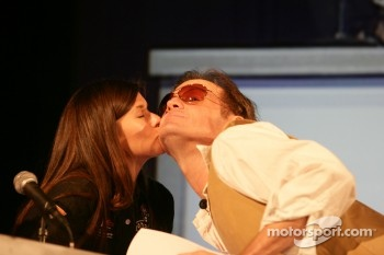 Danica Patrick gives a kiss to Kenny Wallace