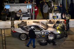 Pit stop for #44 Magnus Racing Porsche GT3: Andy Lally, Richard Lietz, John Potter, Rene Rast
