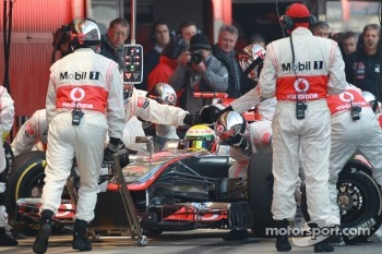 Lewis Hamilton, McLaren Mercedes pit stop practice goes a bit wong when a wheel gun gets stuck and Lewis tries to drive on