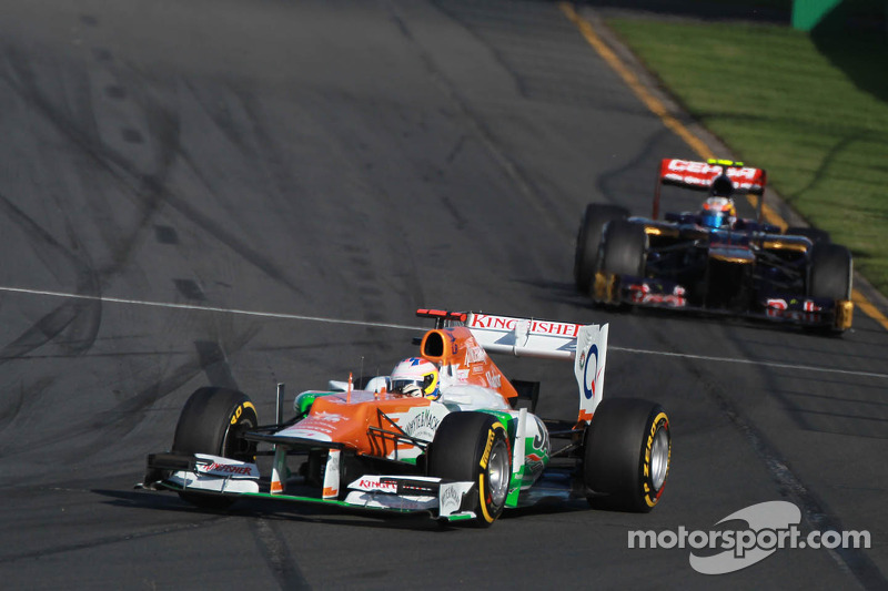 Paul di Resta, Sahara Force India Formula One Team leads Jean-Eric Vergne, Scuderia Toro Rosso