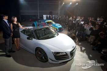 Cyndie Allemann and Audi Japan President Hiroshi Okita pose with the Audi R8 GT Spyder