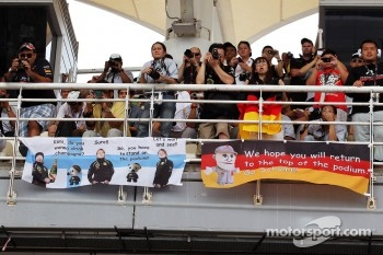 Banners for Kimi Raikkonen, Lotus F1 Team and Michael Schumacher, Mercedes GP and fans