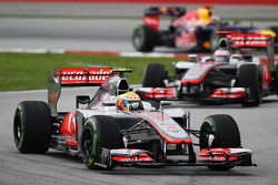 Lewis Hamilton, McLaren leads Jenson Button, McLaren and Sebastian Vettel, Red Bull Racing