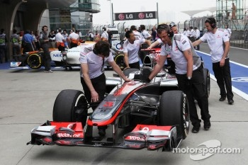 McLaren of Jenson Button, McLaren pushed from scrutineering by mechanics