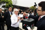 Bernie Ecclestone, CEO Formula One Group, with the circuit holding a raffle in the paddock