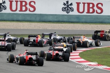 Charles Pic, Marussia F1 Team and Timo Glock, Marussia F1 Team at the start of the race