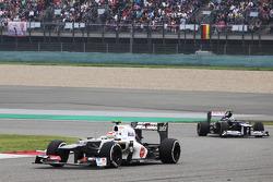 Sergio Perez, Sauber leads Bruno Senna, Williams