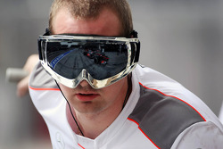 McLaren mechanic with Jenson Button, McLaren Mercedes in his goggles