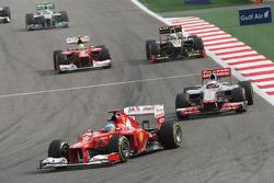 Fernando Alonso, Ferrari leads Jenson Button, McLaren