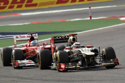 Kimi Raikkonen, Lotus Renault F1 Team leads Fernando Alonso, Scuderia Ferrari