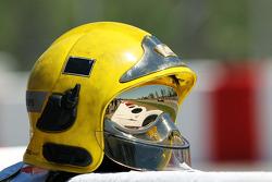 Paul di Resta, Sahara Force India reflected in the visor of a marshall's helmet
