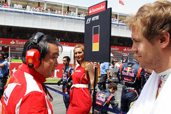 Sebastian Vettel, Red Bull Racing passes Hirohide Hamashima, Scuderia Ferrari Tyre Engineer on the grid