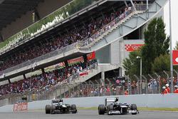 Bruno Senna, Williams leads Vitaly Petrov, Caterham