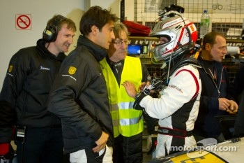 Romain Dumas talk with Lucas Luhr after setting the fastest lap