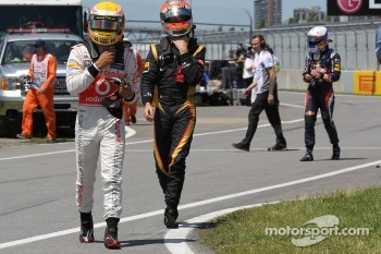 Lewis Hamilton, McLaren Mercedes Mercedes with Romain Grosjean, Lotus Renault F1 Team and Sebastian Vettel, Red Bull Racing