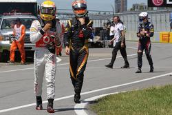 Lewis Hamilton, McLaren Mercedes Mercedes with Romain Grosjean, Lotus Renault F1 Team and Sebastian Vettel, Red Bull Racing