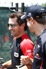 Timo Glock, Marussia F1 Team and Sebastian Vettel, Red Bull Racing