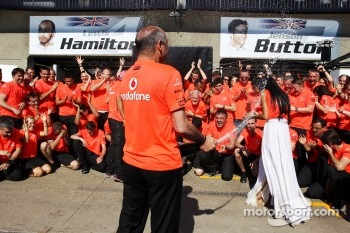 Ron Dennis, McLaren Mercedes Executive Chairman celebrates with the team
