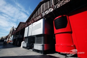 McLaren and Ferrari trucks in the paddock