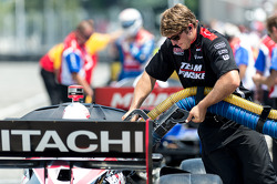 Ryan Briscoe's car gets refueled during a red flag