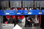 Sebastien Loeb Racing team members have there own pitwall in the garage