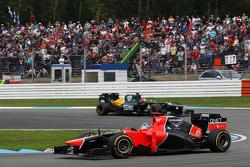 Timo Glock, Marussia F1 Team leads Heikki Kovalainen, Caterham