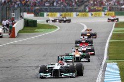 Michael Schumacher, Mercedes AMG F1 leads Nico Hulkenberg, Sahara Force India F1