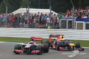 Sebastian Vettel, Red Bull Racing overtakes Jenson Button, McLaren Mercedes