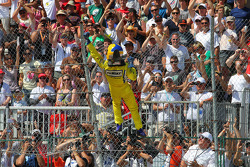 Race winner Helio Castroneves,