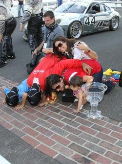Overall race winners Alex Popow, Sébastien Bourdais kiss the yard of bricks