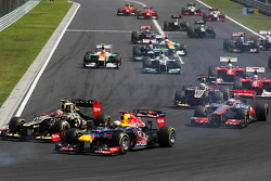 Romain Grosjean, Lotus F1 and Sebastian Vettel, Red Bull Racing battle for position at the start of the race