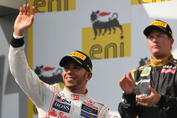 Lewis Hamilton, McLaren Mercedes with Kimi Raikkonen, Lotus Renault F1 Team