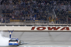 Race winner Elliott Sadler celebrates