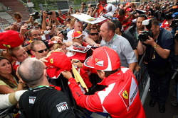 Fernando Alonso, Scuderia Ferrari signing autographs for the fans