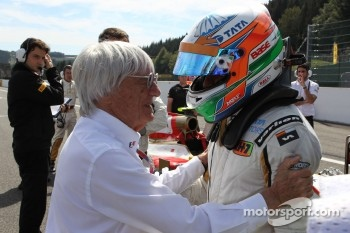 Bernie Ecclestone, and Narain Karthikeyan, HRT Formula One Team
