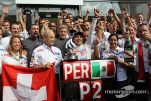 Second place Sergio Perez, Sauber F1 Team celebrates with the team and Peter Sauber, Sauber Team Principal