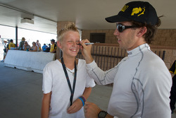 Esteban Guerrieri, Sam Schmidt Motorsports signs the face of a young fan