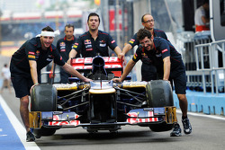 Scuderia Toro Rosso STR7 pushed down the pit lane