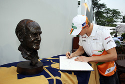 Nico Hulkenberg, Sahara Force India F1 signs a book of condolences for the late Sid Watkins, Former-FIA Safety Delegate